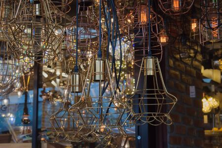 emanate: The background of lighting from many brass chandelier