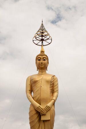 Golden big buddha statue in thai temple Stock Photo