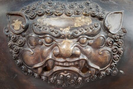 pinchbeck: The brass lion head sculpture in thai temple Stock Photo
