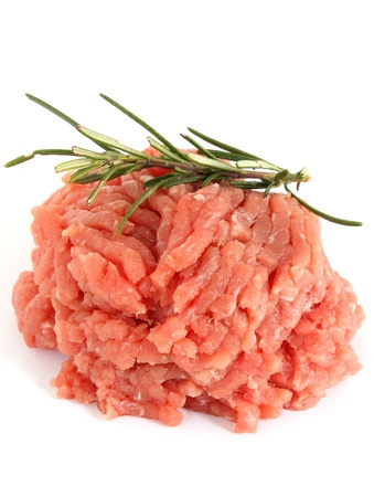 raw minced meat with rosemary photo