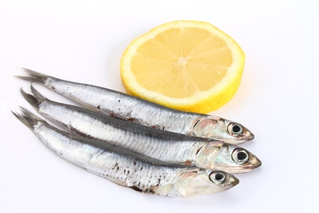 fresh anchovies with lemon Stock Photo