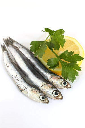 raw anchovies with lemon and parsley photo