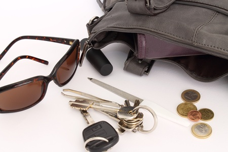 objects inside a woman s bag Stock Photo - 13358751