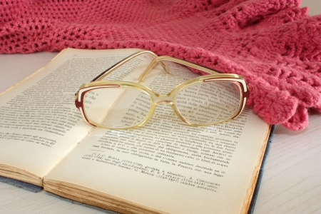 grandma s shawl, glasses and old book photo