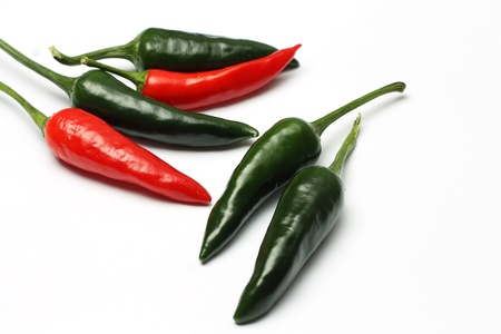 Red and green hot peppers photo