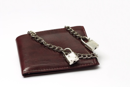Closed wallet tied with chains photo