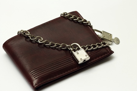 Closed wallet tied with chains Stock Photo