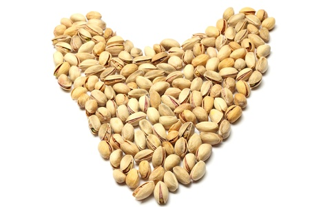 Heart made of pistachio nuts photo