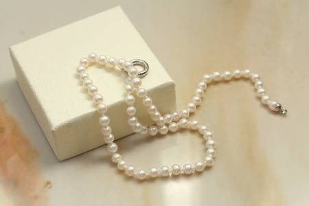 Pearl necklace and gift box photo