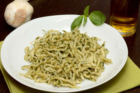 Trofie with pesto sauce photo