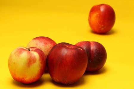 Nectarines on colored background Stock Photo - 20947574