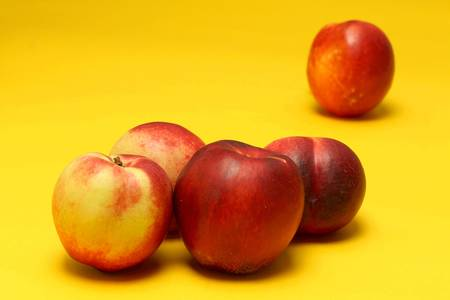 Nectarines on colored background Stock Photo - 20947575