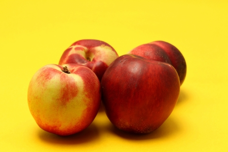 Nectarines on colored background Stock Photo - 20947578