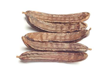 Carob pods isolated on white Stock Photo