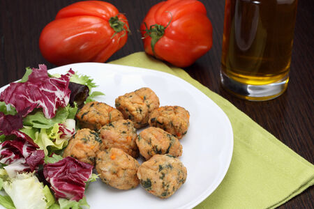 Chicken meatballs with salad and beefsteak tomatoes Stock Photo