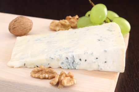 Gorgonzola blue cheese with grapes and walnuts photo