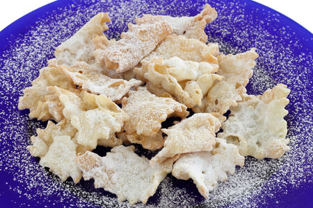 chiacchiere: Chiacchiere -Italian carnival cookies on blue dish Stock Photo