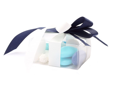 sugared: Blue and white sugared almonds in transparent plastic box Stock Photo