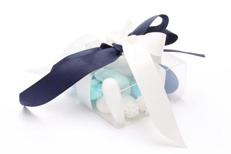 bonbonniere: Blue and white sugared almonds in transparent plastic box Stock Photo