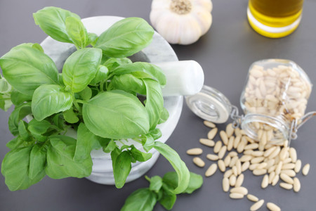 Pine nuts and other pesto sauce ingredients Stock Photo