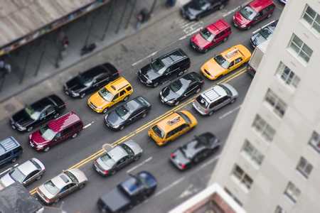 Traffic jam in New York City with yellow cabs, tilt-shift effect
