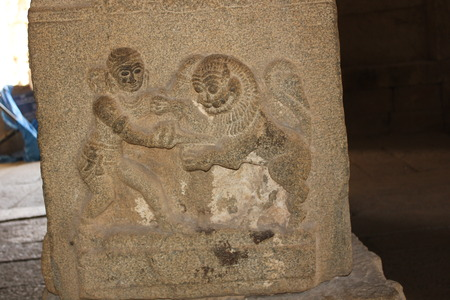 Hampi Vittala Temple pillar carving of human fighting with a lion