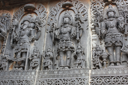 Hoysaleswara Temple wall carving of Brahma Originator Vishnu Guardian and Shiva Destroyer