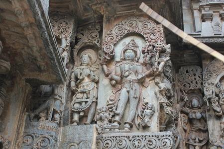 heals: Hoysaleswara Temple wall carving of lord shiva wearing heals