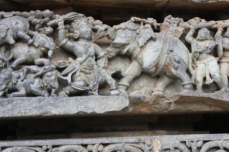 Hoysaleswara Temple Wall carving of bheema killing elephants and the pile of defeated elephants