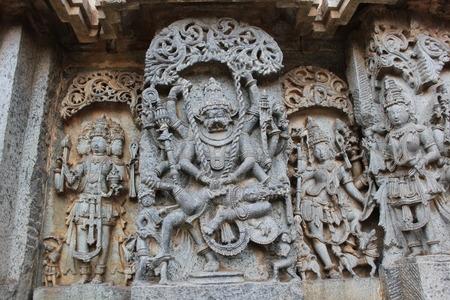 Hoysaleshwara temple wall carving of lord Narasimha killing the demon