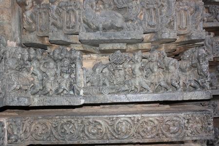 Hoysaleswara Temple wall carving (row of carving) depicting war scene