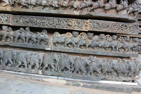 Hoysaleshwara Temple wall carving of various animals like elephant and yali (yazhi) Stock Photo