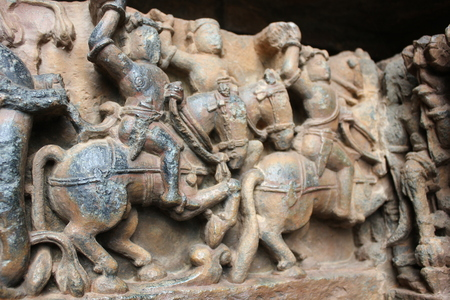 Soldiers carving with full Armour at hoysaleswara temple Stock Photo