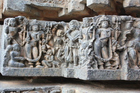 Hoysaleswara Temple wall carving showing the demons dancing Stock Photo