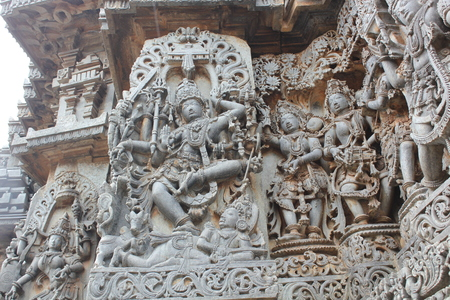 Hoysaleshwara Temple Wall Carving of Lord Shiva Dancing on top of a demon