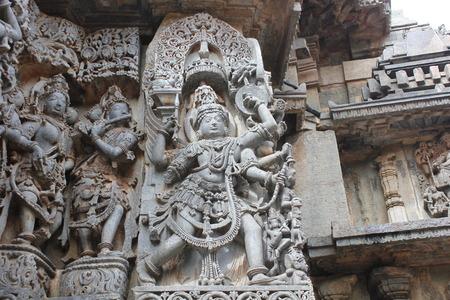 Hoysaleswara Temple wall carving of Garuda - humanoid bird Stock Photo