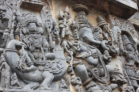 Hoysaleswara Temple Wall carved with sculpture of Lord Ganesha (elephant god) and Lord Brahma (god of creation) Stok Fotoğraf