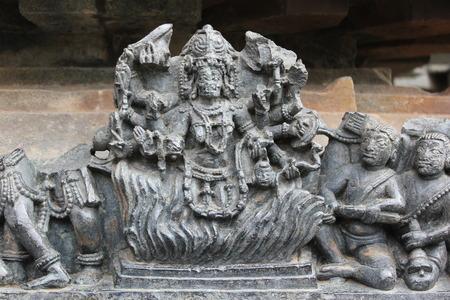 Hoysaleswara temple wall carving of holika and prahlada
