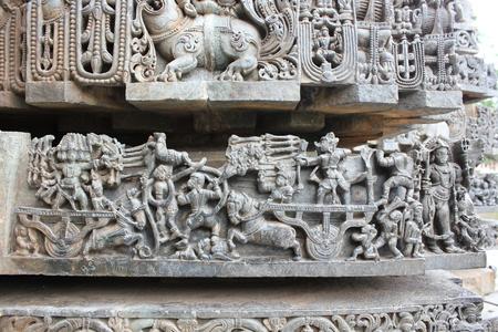 Hoysaleswara temple wall carving depicting Ramayana battle scene Stock Photo