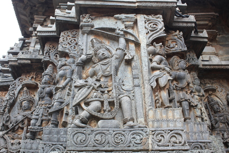 Hoysaleswara Temple wall carving of Arjuna with archery Stock Photo