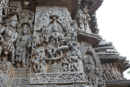 Hoysaleswara Temple Wall carved with sculpture of Goddess Lakshmi standing on Lotus
