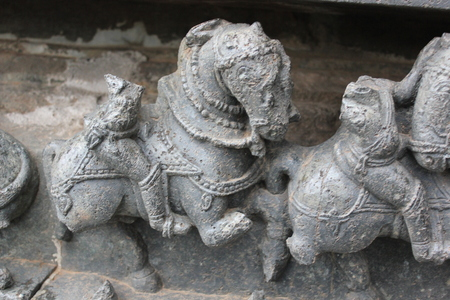 Hoysaleswara Temple broken form of wall carving of horse soldier