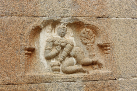Wall carving of baby (bala) krishna eating butter at Gommateshwara Temple, Shravanabelagola Stock Photo