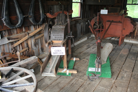 Corn Sheller - Farm Machine works displayed in the Blacksmith shop at Amish village