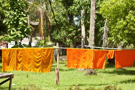 shantytown: Monk s clothing in sun for drying in Luang Prabang Stock Photo