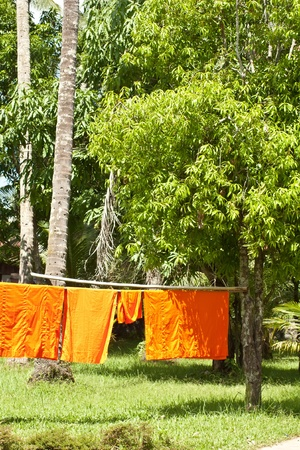Monk s clothing in sun for drying in Luang Prabang photo