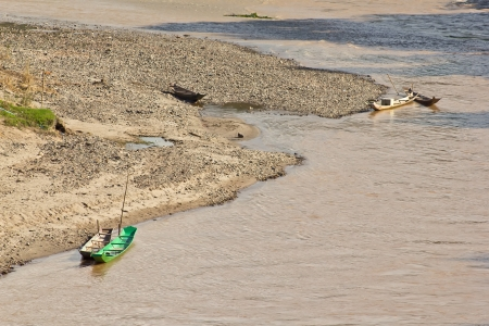 green boat: Lonely  green boat in a river
