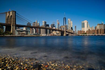 Famous Skyline of New York, Brooklin Bridge at the morning sun light , New York City, USA