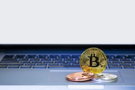 Bitcoin coins on laptop computer track pad Foto de archivo