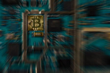 Bitcoin digital currency on electronic print circuit board with zooming effect - conceptual Фото со стока